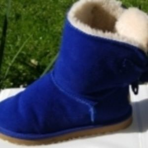 Ugg royal blue boots with ribbon laces.